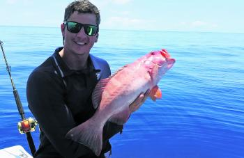 Ben Fielding nailed a dozen quality trout on his first trip to the reef off Cairns in his new boat.