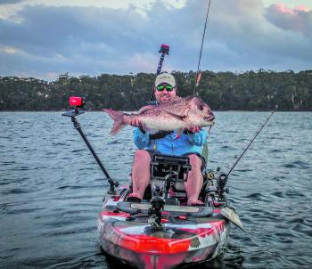 Tim Mcgoldrick with a cracking 7.5kg Jervis Bay red taken on a plastic from his awesome Feelfree kayak setup.
