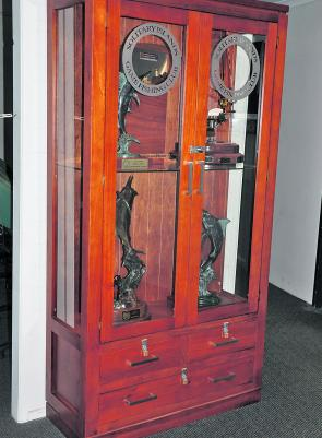 The Solitary Islands Game Fishing Club's perpetual trophies have found a new home in this beautiful display case at the Coffs Harbour Yacht Club.
