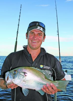 Damien with a typical size pearl perch. Most of the inner reefs have fired and pearl perch have been around in numbers.