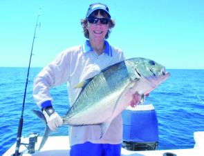 The author with a giant trevally caught on metal lure retrieved at speed across the surface.