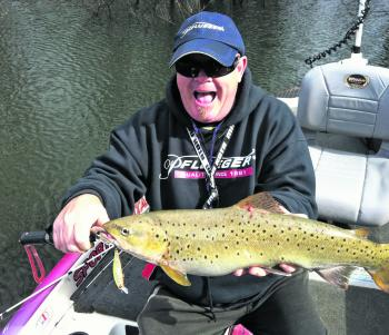 The author with a nice brown trout from the same session.