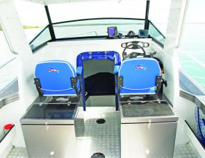 Wide Reelax seats on storage boxes provide excellent driving and observations positions for skipper and first mate.