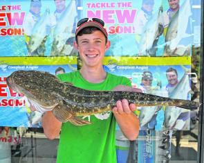Patrick Lawson won the $50.00 Davo's Fish of the Week prize with this 62cm flathead from Weyba Creek.