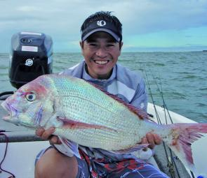 Grayson was quick to net this snapper when it was floating on the surface close to shore at Scarborough Reef.
