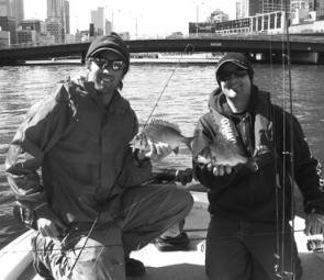 Ben Scullin (right) and the author with the sort of bream that can be taken in the lower Yarra. I bet there were a few workers in skyscrapers who shut the office door, hit 'do not disturb' button on their phones and found some binoculars!