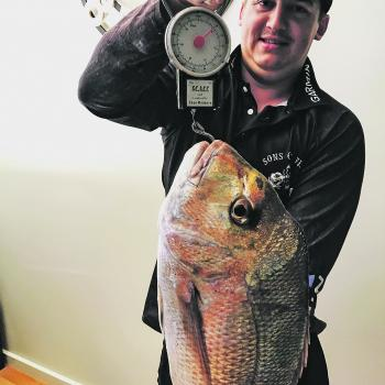 Justin Westbury was determined to be in the mag, so here he is with a fish he bought at the shop.