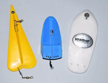 The yellow apparatus on the left has a keel so is therefore a paravane. The blue one in the middle is a bit of a hybrid and the white one on the right (which looks similar to a small surfboard) is a trolling board. All these will do a similar job however