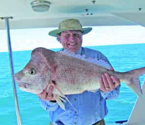 Noosa resident Jack Hyde pulled this 8kg snapper up from the depths on North Reef on a Fishing Offshore Noosa charter.