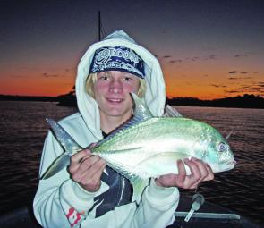 Tom Cels and one of his lure's caught trevally from the Woods Bay area.