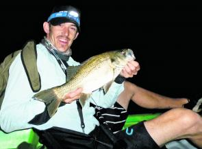 Ryan Thompson is happy with his after-dark bass from the kayak. They've taken a bit of finding lately but should be in the sweetwater soon.