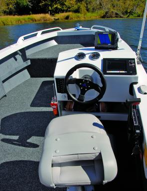The side console was functional yet took up little room, and the skipper's pedestal seat was well designed and supportive.