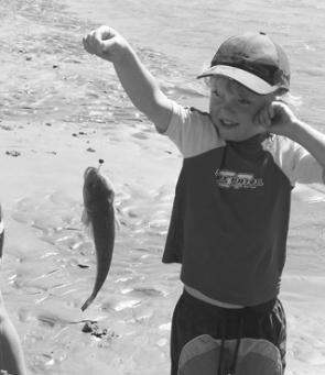 The little fellows love catching flathead too! Harry Fry caught this fish from the riverbank on a live herring bait.