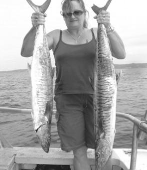 Helen Crouch from Lismore she caught these two Spanish mackerel one after the other at North Reef on a Fishing Offshore Noosa charter trip.