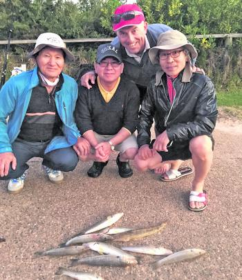 Brothers far left 79yo Benedict and far right Pedro Lee (the father-in-law of photographer Bill Panagiotopoulos), with Mr Jang and me photo bombing. When you meet people like these who have never fished before, it's amazing to see their faces when th