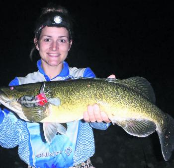 Jema Clark with a decent cod scored off the top using a DoofDoc surface lure.
