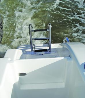 A great addition to the new layout of the Pro Fisherman is a walk through transom, with a hinged gate, making boarding and alighting much easier for the less agile.