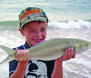 Young Hamish, 7, with his new PB, a hefty salmon caught on whiting gear.