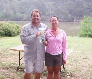 Champion female angler Kim Moller receives her trophy from HNBAA president Tony Devine.