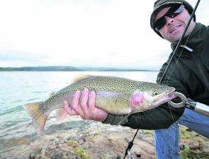 Dael O'Neil with a early winter TCD rainbow trout. This high altitude dam can experience severe weather changes on any given day so it pays to be prepared for the worst.