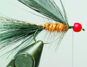 Tie in the collar hackle and take 3-4 turns holding the hackle fibres back as you make each turn. Then whip finish behind the bead.