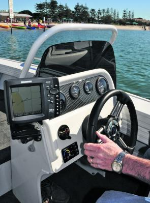 The helm is simple and effective – note the swivel mount for the fish finder.