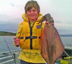 Sam Sherriff with a massive calamari from the heads area of the Tamar River.