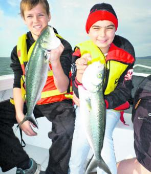 Bryce Lyons and Nathan Breheny had a boatload of fun chasing salmon.