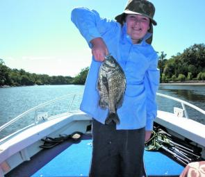 Ben Robertson with a 32cm bream caught at Waterpark Creek.