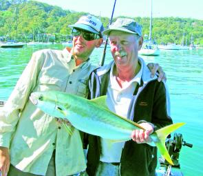 Doug and Peter Tovey enjoy some kingfish action.