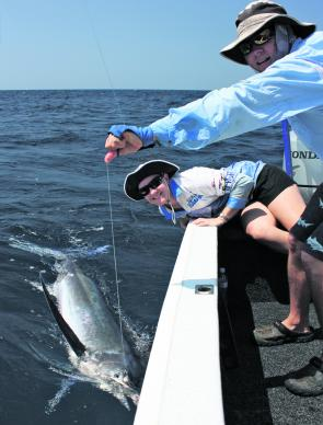 Casey Lyon with her first marlin, a cracker at around 140lb.