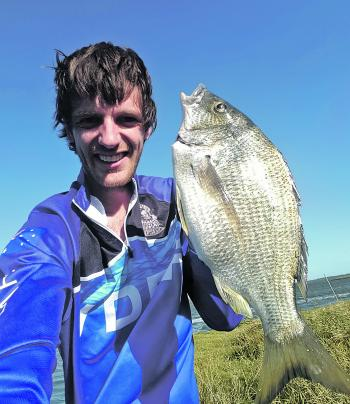 Gun angler Mick Edwards with a 43cm Hollands Landing yellowfin bream caught on a live mullet and 4/0 circle hook!