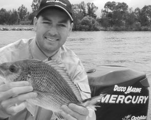 Jason Disson with a bream caught on one of the many flats the Clarence River has to offer. The shallows have been the shining light in a pretty ordinary estuary season.