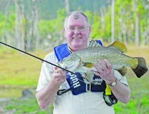 Keith Day shows off a hard won fly-caught barra from Teemburra dam.