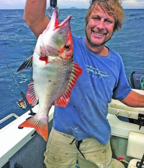 Tom Wegener with a red throat emperor caught early morning on Sunshine Reef.