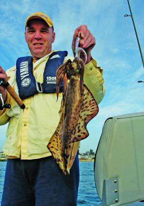 Tony Hiam with a good winter calamari from Port Phillip Bay. Pic Courtesy Marc Ainsworth.