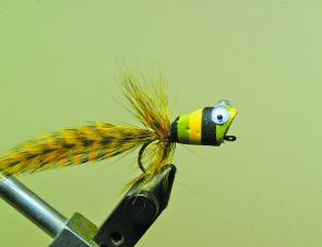 Wind the hackle on separately ensuring the fibres slope back wet fly style, Tie off and remove the thread