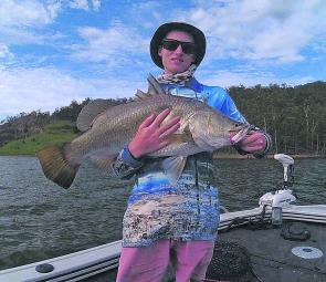 MAFSA member Cameron Christian with his best Teemburra barra, a 82cm fish caught on a Duo Realis hardbody.