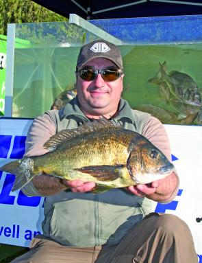 Jim Xyga from Team EVX displays one of the 2 1.7kg tied Eco-Gear Big Bream