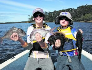 Youngsters Jessie (11) and Brock (9) with snapper, flathead and flounder caught on a recent trip. The boys and their dad Brad had a great week's fishing around the region.