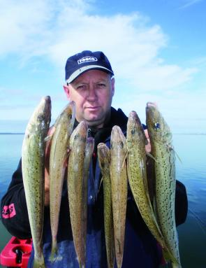 Colin displays a handful whiting caught on circle hooks.