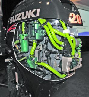 This factory cut-away Suzuki DF20A shows the high-and low-pressure fuel pumps and vapour separator and the fuel lines of the injection system.