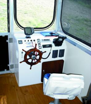 The helm of the houseboat is simple and easy to operate.