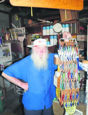 Les Barlow in his workshop with a few of his hand-made lures.