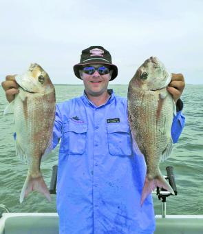 Ron Smith holds two magnificent snapper from the Rhyll area.
