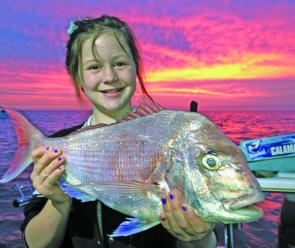 Tessa Petrie with one of 10 snapper she caught herself during a hectic session with her dad Matt.