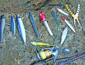 Kingfish stickbaits are proving very popular on the rocks and, yes, the author has an unhealthy lure addiction. From left, the River2Sea 200 Wide Glide, FCL Labo Squid Pen, CB One Zorro, Adhek Bali Short Penipen, RapalaXRap, River2Sea Doggie WP, random ji