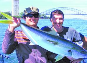 Andrew Parkes and Mingh with yet another decent kingfish caught on the downrigger using live squid.