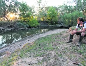 Joey Barca watches over a very nice looking stretch of northeast Victorian water. We had just fished the hole with spinnerbaits from the sandbar, and were sitting down changing our lures to surface poppers to work the hole again after sunset. Note the gum