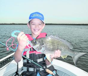 Young Logan Jones with a smile from ear to ear with a great bream. The bream was very clean and may have only visited the river for a quick feed.